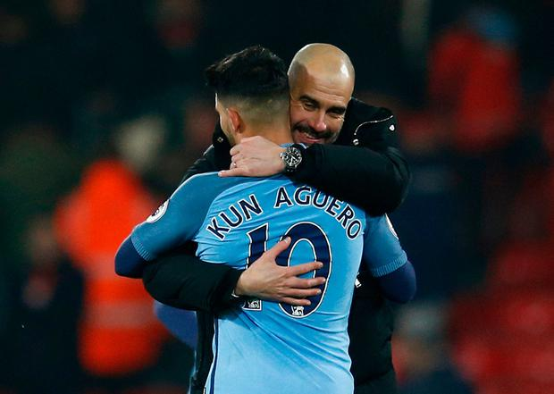 Manchester City manager Pep Guardiola celebrates with Sergio Aguero after the game