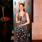 Emma Stone with her BAFTA award for best actress. Photo: Dominic Lipinski/PA Wire