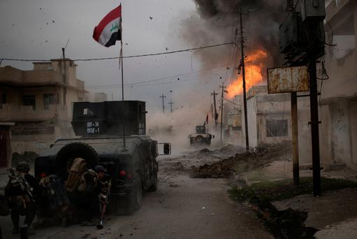 A car bomb explodes next to Iraqi special forces armored vehicles as they advance towards Islamic State held territory in Mosul, Iraq. Photo: REUTERS