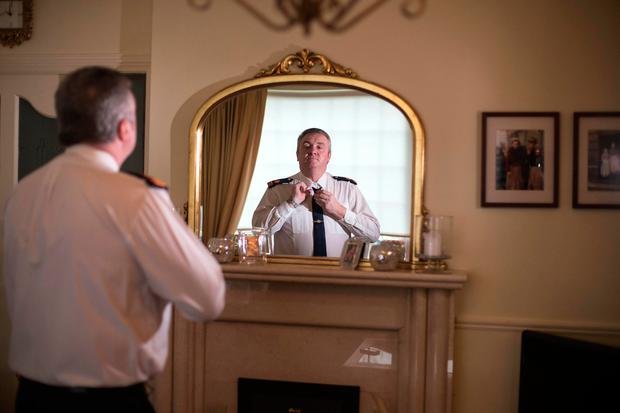 Superintendent Dave Taylor gets ready at his home to go back to work at Dublin Castle.