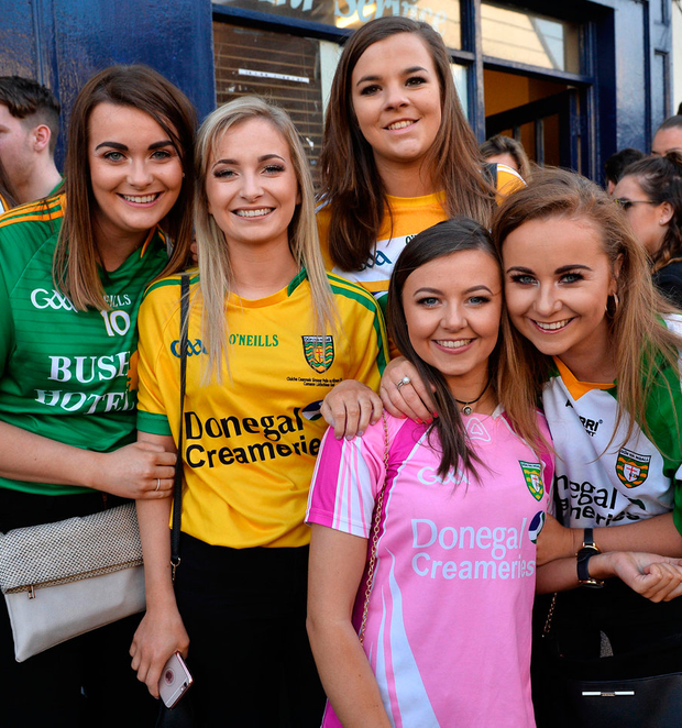 Students outside the Hole In The Wall pub in Donegal jerseys Photo: Ray Ryan