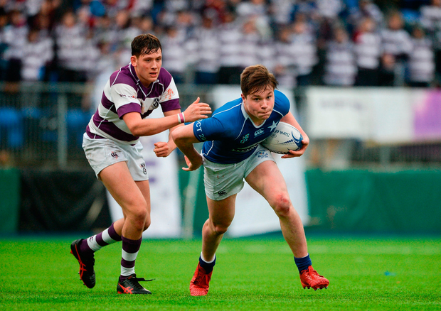Myles Carey of St Mary's College is tackled by Tim O'Brien of Clongowes Wood College. Photo: Daire Brennan/Sportsfile