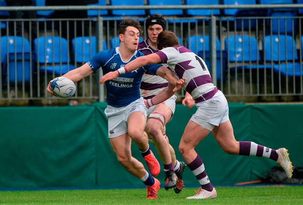 Alex Dix of St Mary's College is tackled by Thomas Monaghan of Clongowes Wood College. Photo: Daire Brennan/Sportsfile