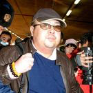 Kim Jong Nam, eldest son of then North Korean leader Kim Jong Il, is surrounded by the media upon arrival from Macau at Beijing airport in Beijing (Kyodo News via AP, File)