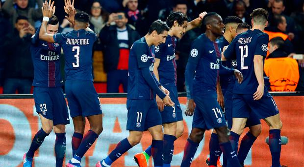 PSG's Julian Draxler, left, celebrates with teammates after scoring his team's second goal