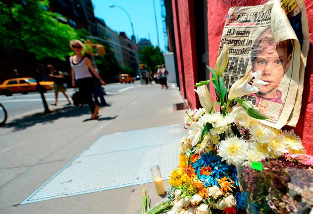 People walking past a street shrine to six-year-old Etan Patz, who disappeared on May 25, 1979. AFP PHOTO / EMMANUEL DUNANDEMMANUEL DUNAND/AFP/Getty Images