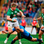 Jamie Heaslip of Ireland is tackled by Tommaso Benvenuti of Italy