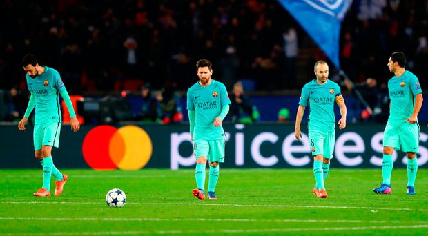 (L-R) Sergio Busquets, Lionel Messi, Andres Iniesta, Luis Suarez and Samuel Umtiti of Barcelona dejected during the first leg match against Paris Saint-Germain. Photo: Clive Rose/Getty Images
