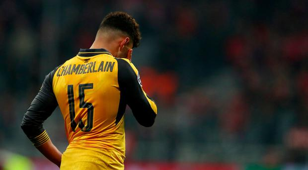 Arsenal's Alex Oxlade-Chamberlain looks dejected after the game. Reuters / Michael Dalder Livepic