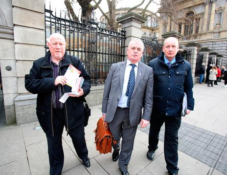 Dermot O'Leary, general secretary of the NBRU, centre, accompanied by national executive members Sean Thunder, left, and Michael Kenefnic, arriving for the Oireachtas Transport Committee meeting at Leinster House. Photo: Tom Burke