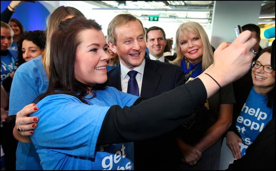 Taoiseach Enda Kenny poses for a photo alongside Minister Mary Mitchell O'Connor for employee Vanessa Moran at a Jobs announcement at Indeed's Headquarters on St Stephens Green. Photo: Steve Humphreys