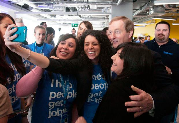 Taoiseach Enda Kenny with staff during an announcement by recruitment website Indeed of 500 new jobs at its Dublin headquarters yesterday. Photo: Gareth Chaney