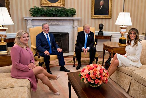 US President Donald Trump, Israeli Prime Minister Benjamin Netanyahu, his wife Sara Netanyahu (left) and US First Lady Melania Trump in the Oval Office of the White House, Washington, DC, during Mr Netanyahu's state visit Photo: Andrew Harrer-Pool/Getty