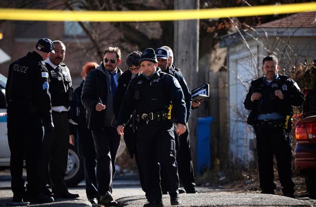 Chicago police investigate the scene of a fatal shooting near Ogden and Kostner avenues in the Lawndale neighborhood Tuesday, Feb. 14, 2017. (E. Jason Wambsgans/Chicago Tribune via AP)
