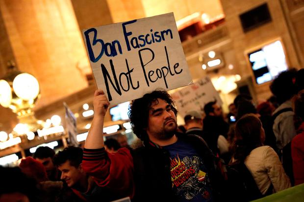 A demonstrator holds a sign during a