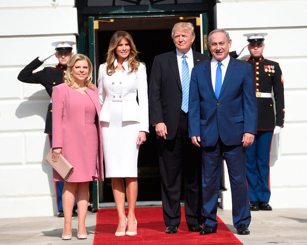 TOPSHOT - US President Donald Trump and First Lady Melania Trump welcome Israeli Prime Minister Benjamin Netanyahu and his wife, Sara, as they arrive at the White House in Washington, DC, February 15, 2017. / AFP PHOTO / SAUL LOEBSAUL LOEB/AFP/Getty Images