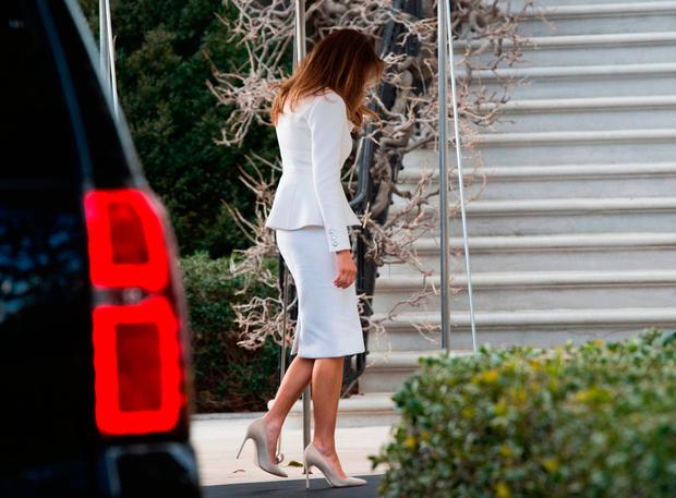 First lady Melania Trump walks into the White House after touring the Smithsonian National Museum of African American History and Culture with Sara Netanyahu, wife of Israeli Prime Minister Benjamin Netanyahu in Washington, DC