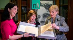 Heritage Minister Heather Humphreys looks at the manuscripts with Sandra Collins (left), director of the National Library of Ireland, and Caitríona Yeats, WB's granddaughter. Photo: Mark Condren
