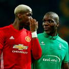Paul Pogba and his brother Florentin leave the pitch at half-time during the Europa League match at Old Trafford last night. Photo: Andrew Yates/Reuters