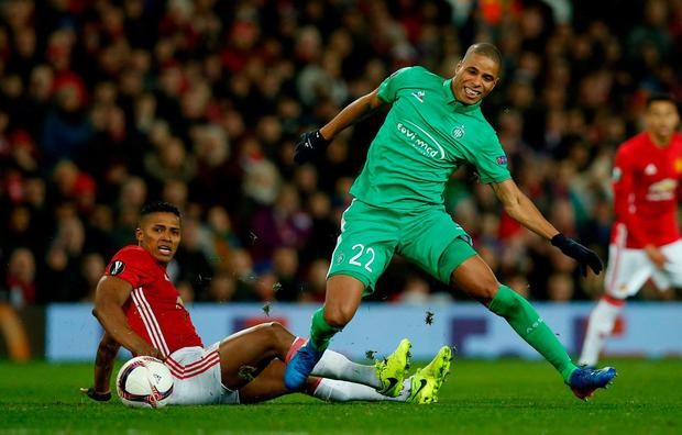 St Etienne's Kevin Monnet-Paquet in action with Manchester United's Antonio Valencia. Photo: Andrew Yates/Reuters
