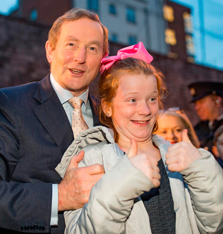 Taoiseach Enda Kenny with 11-year-old local girl Emily Spain at a media briefing in Sheriff Youth Club to launch Kieran Mulvey's report. Photo: Arthur Carron