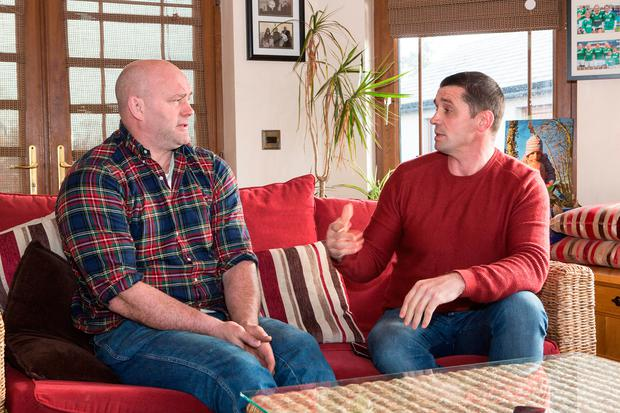 Alan Quinlan in conversation with John Hayes in his sitting room in Cappamore, Co. Limerick. Photo: Liam Burke Press