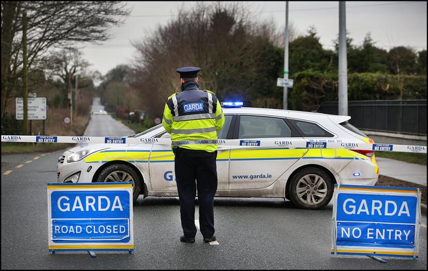 Gardai at the closed off section of road from Summerhill to Rathmolyon in Co Meath where the fatal hit and run took place. Pic Steve Humphreys