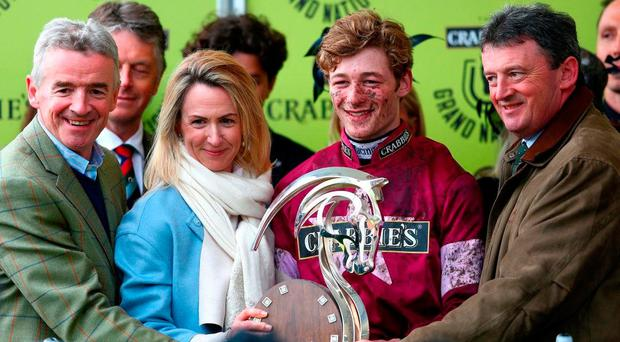 Michael O'Leary, his wife Anita, and jockey David Mullins after last year's Aintree Grand National success with Rule The World. Photo by Michael Steele/Getty Images