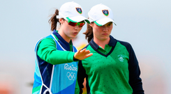 Leona Maguire with her twin sister and caddy Lisa discussing the putt during the final round of the women's golf during the 2016 Rio Summer Olympic Games. Photo by Stephen McCarthy/Sportsfile