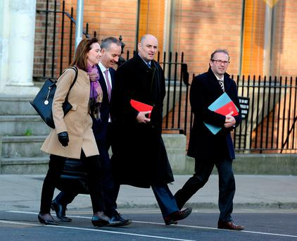 Ray Hernan (second left), acting CEO of Bus Éireann, and officials arriving at the Oireachtas meeting Picture: Tom Burke