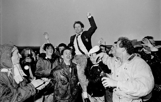 Brian Kerr is lifted by fans after winning the 1990 league title. Photo: Ray McManus/Sportsfile