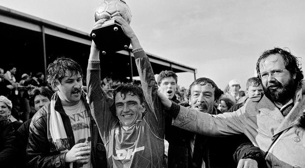 Irish Independent reporter and St Patrick's Athletic supporter David Kelly celebrates behind midfielder Pat Fenlon after the team beat Drogheda in United Park to win the 1990 League of Ireland Premier Division title. Photo: Ray McManus/Sportsfile