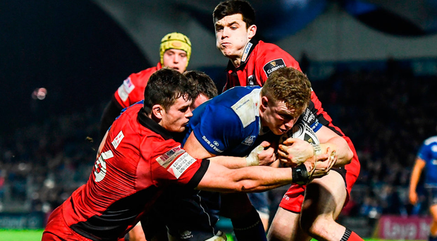 Leinster's Dan Leavy goes over to score his side's fifth try despite the attention of Magnus Bradbury of Edinburgh. Photo:Stephen McCarthy/Sportsfile