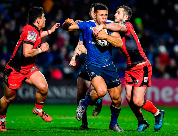 Leinster's Adam Byrne is tackled by Edinburgh's Jason Tovey during the Guinness PRO12 Round 15 match at the RDS Arena. Photo: Brendan Moran/Sportsfile