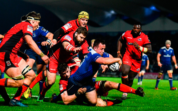 Leinster's Bryan Byrne goes over to score his side's sixth try despite the tackle of Edinburgh's Magnus Bradbury. Photo: Stephen McCarthy/Sportsfile