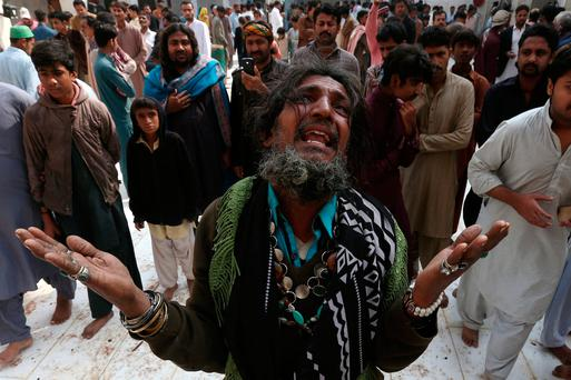 A man mourns the death of a relative who was killed in a suicide bombing at the tomb of Sufi saint Syed Muhammad Usman Marwandi in Sehwan. Photo: Reuters