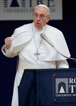 Pope Francis gestures as he talks during a meeting at the University Roma Tre in Rome, Italy.