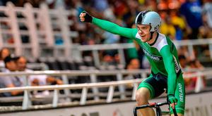 Mark Downey of Ireland celebrates after winning gold medal in the UCI Cycling World Cup, Men's Points Race final, at Alcides Nieto Patino velodrome yesterday