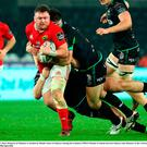 Dave Kilcoyne of Munster is tackled by Rhodri Jones of Ospreys during the Guinness PRO12 Round 15 match between Ospreys and Munster at the Liberty Stadium in Swansea, Wales. Photo by Darren Griffiths/Sportsfile