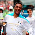 File photo dated 29/8/2012 of Michael Watson carrying the Paralympic Flame.