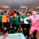 The Lincoln players enjoy the dressing-room celebrations after their determined display. Photo: Getty Images