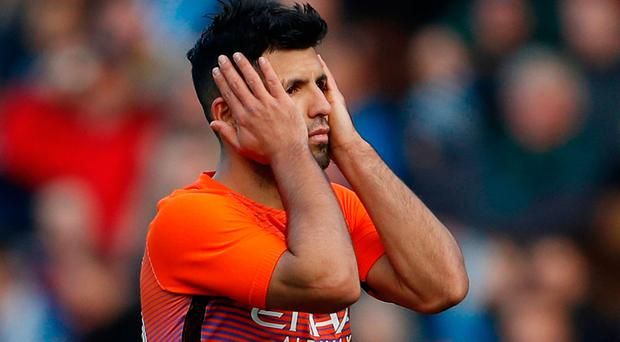 Sergio Aguero looks dejected as yet another goal attempt goes awry. Photo: Reuters