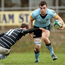 UCD's Andy Marks is tackled by Garryowen's Ronan O'Halloran at Dooradoyle