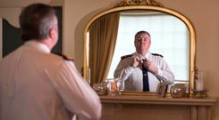 Much to reflect on: Superintendent Dave Taylor gets ready at his home to go back to work at the traffic corps at Dublin Castle