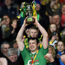 Carrickshock's John Tennyson lifts the cup. Photo: INPHO