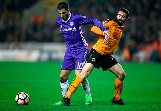 Chelsea's Eden Hazard (left) and Wolverhampton Wanderers' Jack Price battle for the ball Photo: Nick Potts/PA Wire