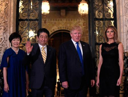 President Donald Trump, second from right, and first lady Melania Trump, right, stop to pose for a photo with Japanese Prime Minister Shinzo Abe, second from left, and his wife Akie Abe, left, before they have dinner at Mar-a-Lago in Palm Beach, Fla. (AP Photo/Susan Walsh)