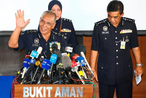 Malaysia's National Police Deputy Inspector-General Noor Rashid Ibrahim (L) gestures during a news conference regarding the apparent assassination of Kim Jong Nam, the half-brother of the North Korean leader, at the Malaysian police headquarters in Kuala Lumpur, Malaysia, February 19, 2017. REUTERS/Athit Perawongmetha