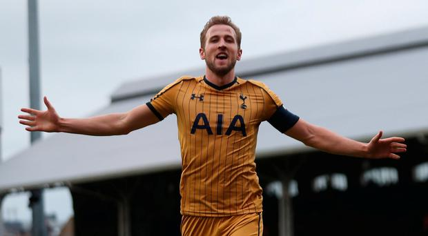 Tottenham's Harry Kane celebrates scoring his third
