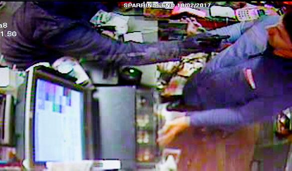 A cashier is threatened with a gun in an armed raid on the Spar shop in Ringsend.